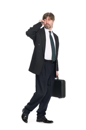 Hurrying businessman talking on the mobile phone. Stock Photo - 10309357