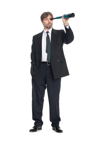 Businessman looking through a spyglass. Prospects for future business. photo