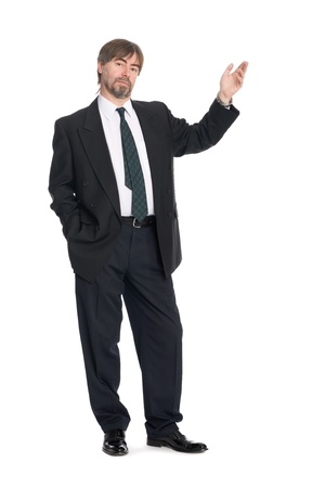 Middle aged businessman pointing at copyspace.   photo