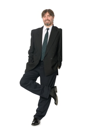 Smiling businessman standing on one leg and rests on an invisible wall (blank space for advertising). Stock Photo - 10309489