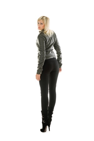 Beautiful girl in leather jacket and jeans. photo