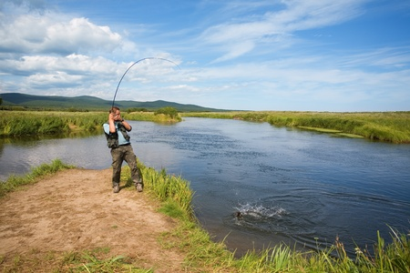 Fisherman catches of salmon (pink salmon) on the river mouth. Stock Photo - 10316609