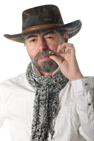 Stylish middle aged man with a smoking cigar. photo