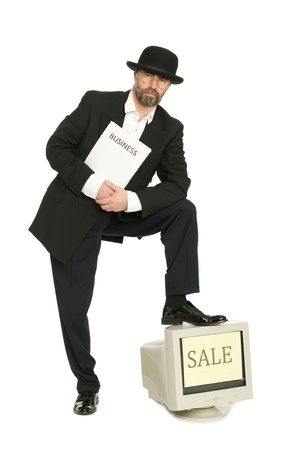 Middle aged businessman in a retro business suit sells old computer. photo