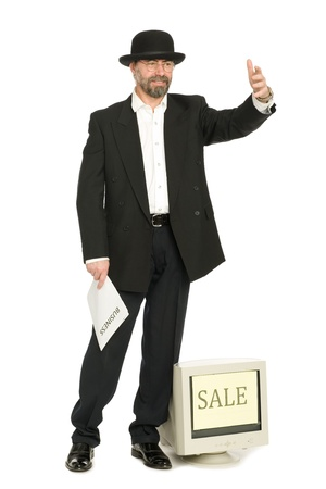 Middle aged businessman in a retro business suit sells old computer. Stock Photo - 10319046