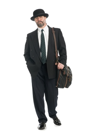 Businessman in a bowler and a bag for travel. photo