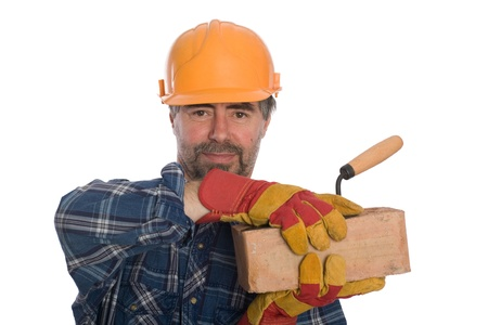 Smiling bricklayer with trowel and brick. photo