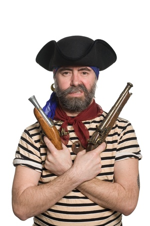 tricorn hat: Terrible bearded pirate in tricorn hat with a muskets. Stock Photo