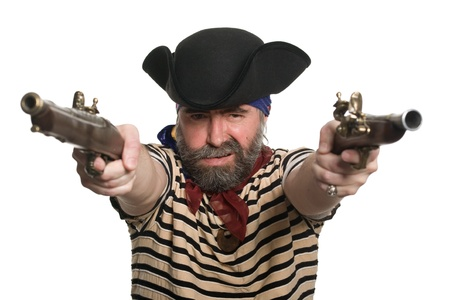 Terrible pirate in tricorn hat with a muskets. photo