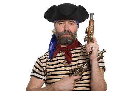 Terrible bearded pirate in tricorn hat with a muskets. photo
