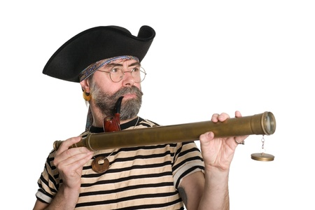 scoundrel: Pirate holds a telescope and smokes a pipe. Stock Photo