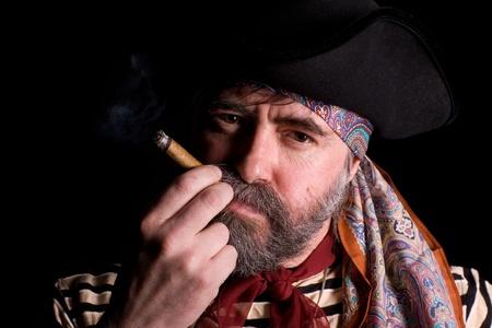 ransack: Sea pirate smoking a cigar. Stock Photo