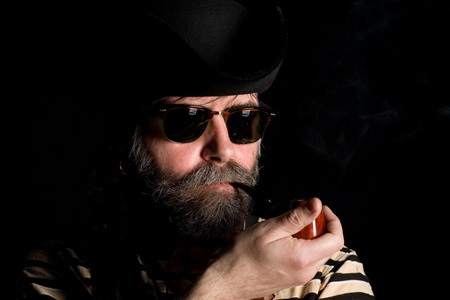 ransack: Man dressed as a pirate in tricorn hat smoking a pipe.