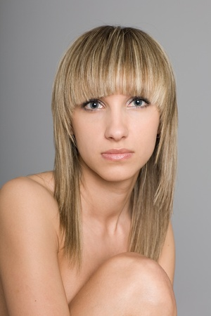 Portrait of a young woman with bare shoulders. photo