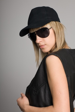 Attractive blonde girl in a sunglasses and cap. photo