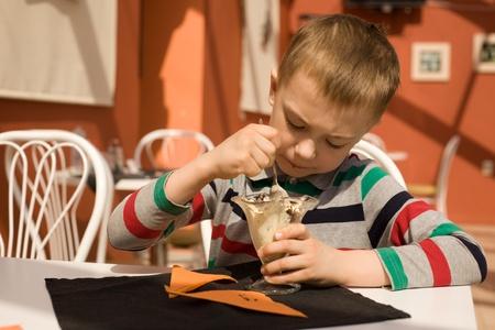 Little boy eating ice cream in a restaurant photo