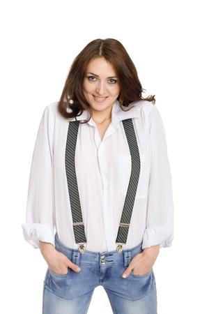 Mooie jonge vrouw in spijkerbroek met bretels. Stockfoto