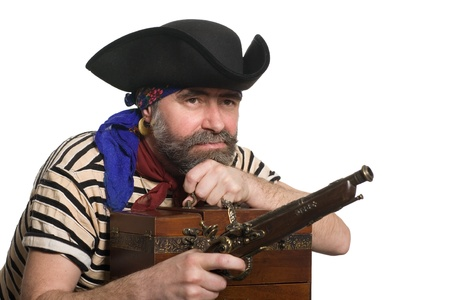 ransack: Pirate with a musket holding a treasure chest.  Stock Photo