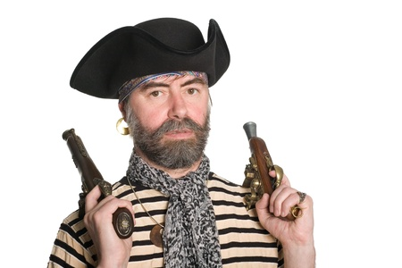scoundrel: Terrible bearded pirate in tricorn hat with a muskets. Stock Photo