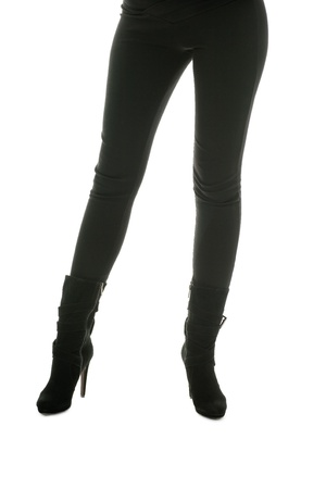 Shapely legs, a young woman in tight pants and leather boots. photo