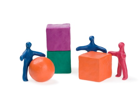 Business teamwork - right decision. Plasticine. Isolated. photo