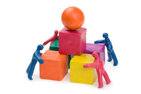 business activity: Business teamwork - collective problem solving. Plasticine. Isolated. Stock Photo
