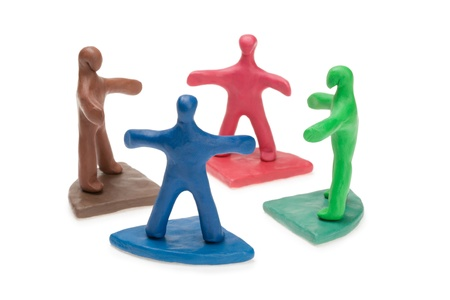 Team of plasticine people in a circle photo