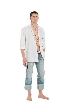 Retrato de un joven apuesto con auriculares. Foto de archivo