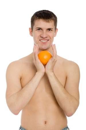 Handsome smiling young man with an orange. Stock Photo - 10333002