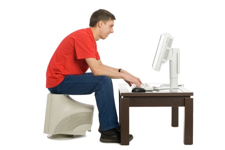 A young man bought a new computer to replace the old. Stock Photo - 10332980