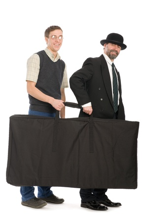 Senior and young businessmen holding the bag. On the white space can add text of your advertisement. photo