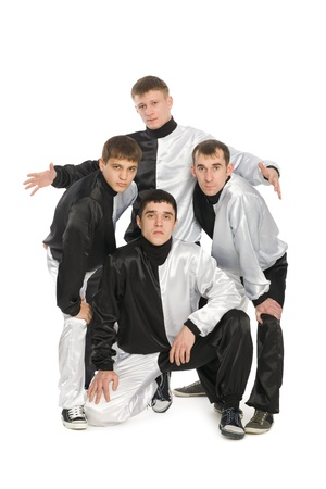 Portrait of a team of young break dancers in stylish uniforms.  photo