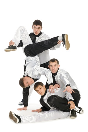 Portrait of a team of young break dancers with elements of dance in stylish uniforms.  photo