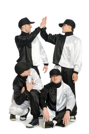 Portrait of a team of young break dancers in stylish uniforms. Friendly greeting. photo