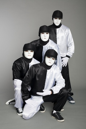 Portrait of a team of young break dancers in stylish uniforms on a gray background. photo