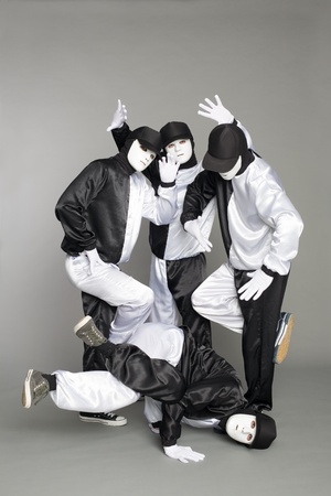 Portrait of a team of young break dancers with elements of dance in mask. photo
