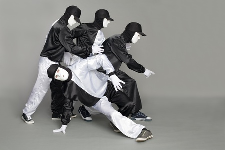 Portrait of a team of young break dancers with elements of dance in mask. Stock Photo - 10333016