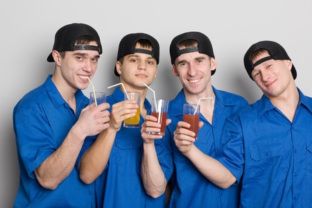 Group of attractive friends drinking juice. photo