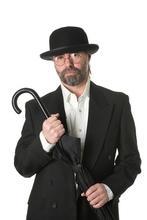 Middle aged businessman in a business suit and an umbrella in his hand photo