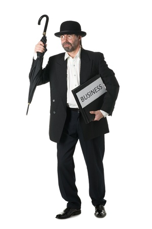 Middle aged businessman in ar retro business suit with a business book. photo