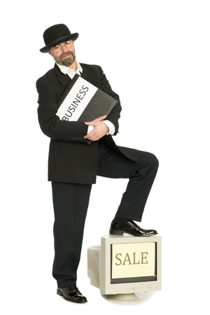 Middle aged businessman in a retro business suit sells old computer. Stock Photo - 10407810