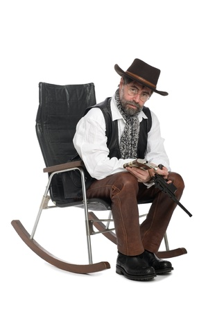 A man dressed as a retro with a Mauser and a flask in his hands. photo