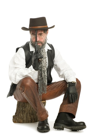 Man dressed as a retro style with a Mauser sitting on the log. photo