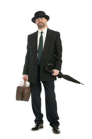 Businessman with an old bag and umbrella photo