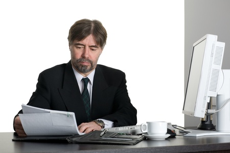 Successful businessman with computer in the office. photo