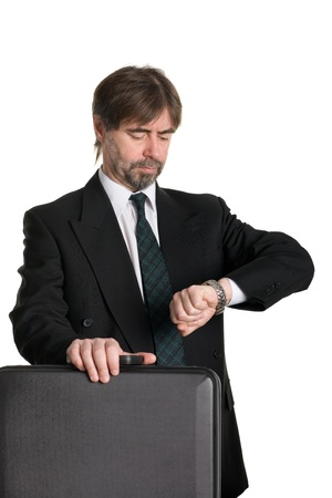 age 50 55 years: Businessman with suitcase looking at your watch.