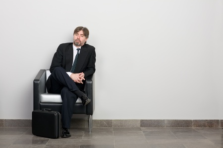 50 55: Businessman waiting for business meeting. Stock Photo