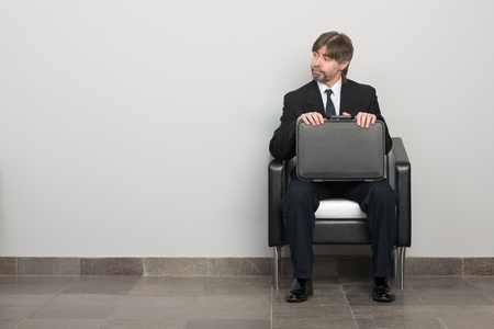 age 50 55 years: Businessman waiting for business meeting. Stock Photo