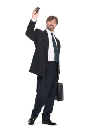 50 55 years: Businessman with arm raised in salute. Stock Photo