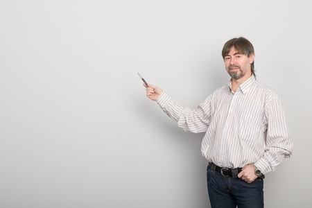 Lecturer stands in the background of an empty gray wall Stock Photo - 10407840